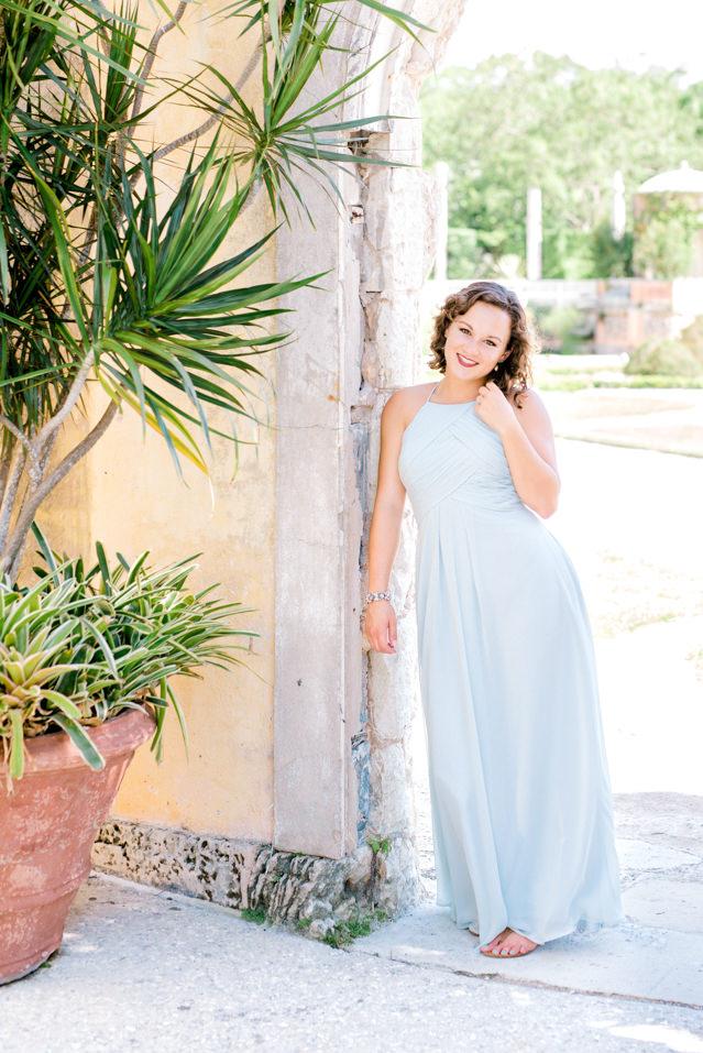 woman portrait wearing blue bridesmaid dress at old spanish building abilene texas